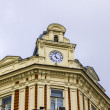 The clock on the building of the railway management - Stock Photo