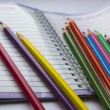 Colored pencils on a notepad — Stock Photo