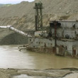 Dredge barge on river. Gold mine. - Stock Photo