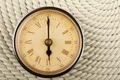 Horloge avec chiffres romains sur fond de cordon. 6 — Photo
