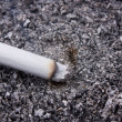Stock Photo: Cigarette in ashtray