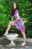 Beautiful girl in a summer garden — Stock Photo