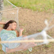 Young woman on hammock — Stock Photo
