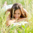 Woman read book in the park — Stock Photo