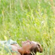 Woman lie in the park — Stock Photo