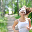 Young smiling jogger — Stock Photo