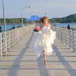 Happy bride on the bridge — Stock Photo