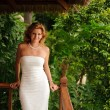 Woman in white wedding dress — Stok fotoğraf
