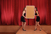Two girls hold empty board — Stock Photo