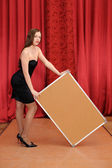 Girl hold empty board — Stock Photo