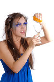 Girl making orange drink — Stock Photo