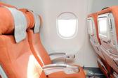 Orange platserna i flygplan — Stockfoto