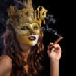 Woman in golden mask — Stock Photo #13878436