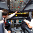 Pilots in aircraft after landing — Stock Photo