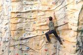 Man on rock wall — Stock Photo