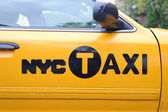 Door of Yellow NYC taxi — Stock Photo