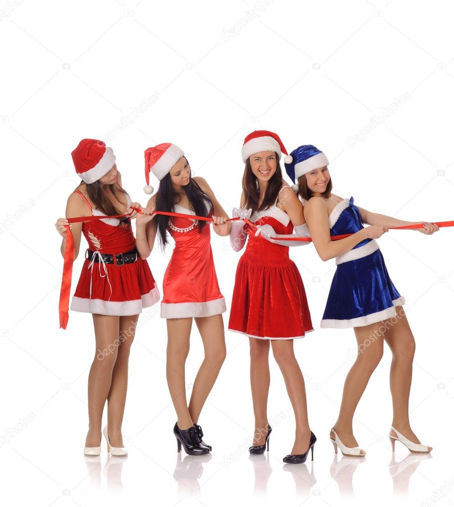 four beautyful girls pull red ribbon u2014 stock photo teamtime