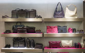 Bags on shelfes in boutique — Stock Photo
