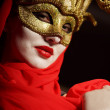 Woman in golden party mask — Stock Photo #26962413