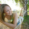 Woman on hammock in the park — Stock Photo #26962461