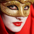 Woman in golden party mask — Stock Photo