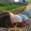 Woman on hammock in the park — Stock Photo
