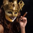 Woman in golden mask — Stock Photo