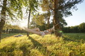 Woman on hammock in the forest — Stock Photo