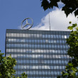 Mercedes Benz logo on rooftop of high rise building — Stockfoto #39679095
