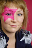 Teenager with pink star on the face — Stock Photo