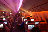 Emirates interior of Boeing-777 aircraft at night — Photo