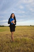 Business woman on green field — Stock Photo