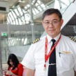 Постер, плакат: Airasia crew members in Bangkok Airport