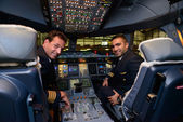 Pilots in Emirates Airbus A380 aircraft after landing — Stock Photo