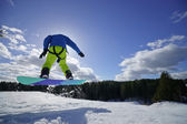 Man on the snowboard jumping — Stock Photo