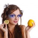 Woman with lemon earring — Stock Photo #9779624