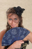 Portrait with a fan — Stock Photo
