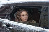 Bride in the car — Stock Photo