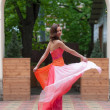 Stock Photo: Girl in bright evening gown