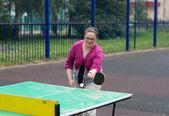 Girl plays table tennis — Stock Photo