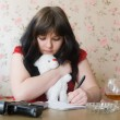 Girl writes a farewell letter — Stock Photo