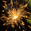 Sparklers and spruce branches — Stock Photo #37990457
