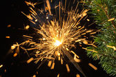 Sparklers and spruce branches — Stock Photo