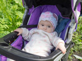 Baby in a stroller — Stock Photo
