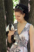 Girl with her beloved pet rabbit — Stock Photo