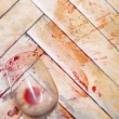 Broken wine glass on the old parquet. Splashes of wine similar t — Stock Photo
