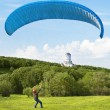 Paraglider. Man with parachute struggling with the wind. In the  — Stock Photo