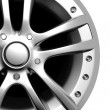 Stock Photo: Car wheel on a white background