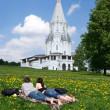 Man and woman on the lawn outside the church — Stock Photo