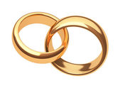 Gold rings on a white background — Stock Photo